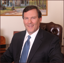 Bankruptcy Attorney Eric S. Ruff,  seated at his desk in his Gainesville office.